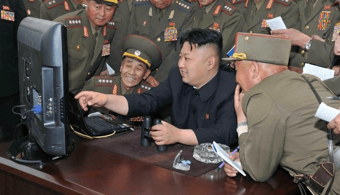 Kim Jong-un with colleagues (2014)